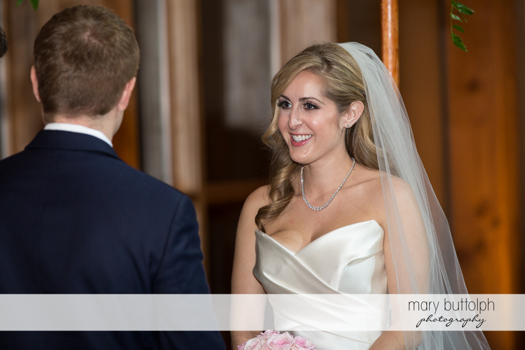 Bride smiles at the groom at the Lodge at Welch Allyn Wedding