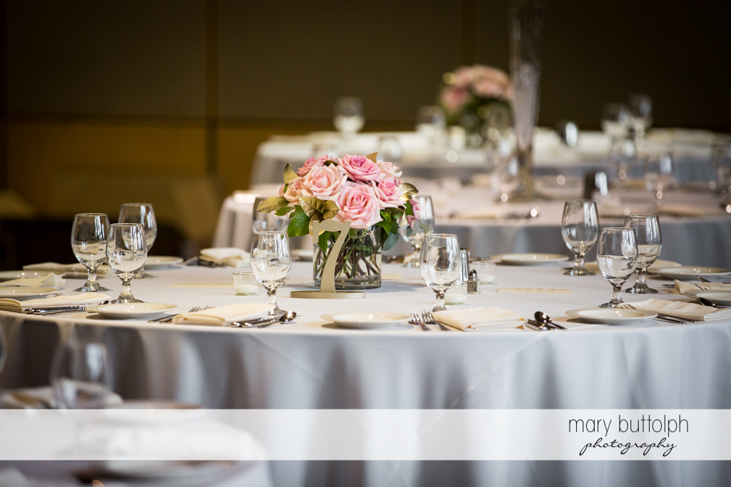 Flowers adorn the tables at the wedding reception at the Lodge at Welch Allyn Wedding