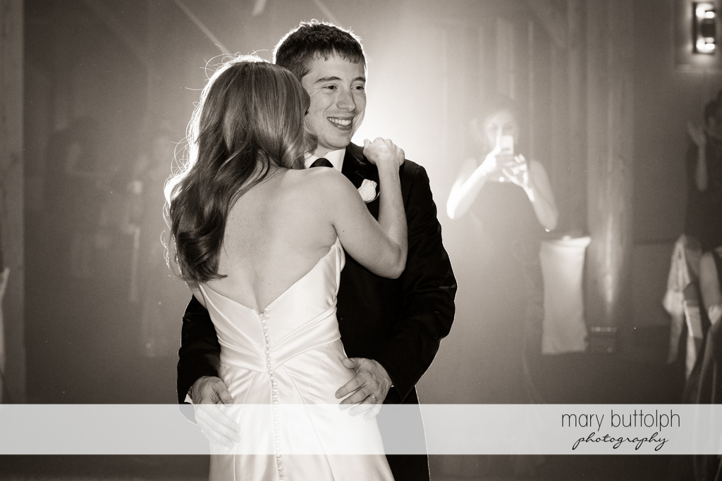 Couple embrace while dancing at the Lodge at Welch Allyn Wedding