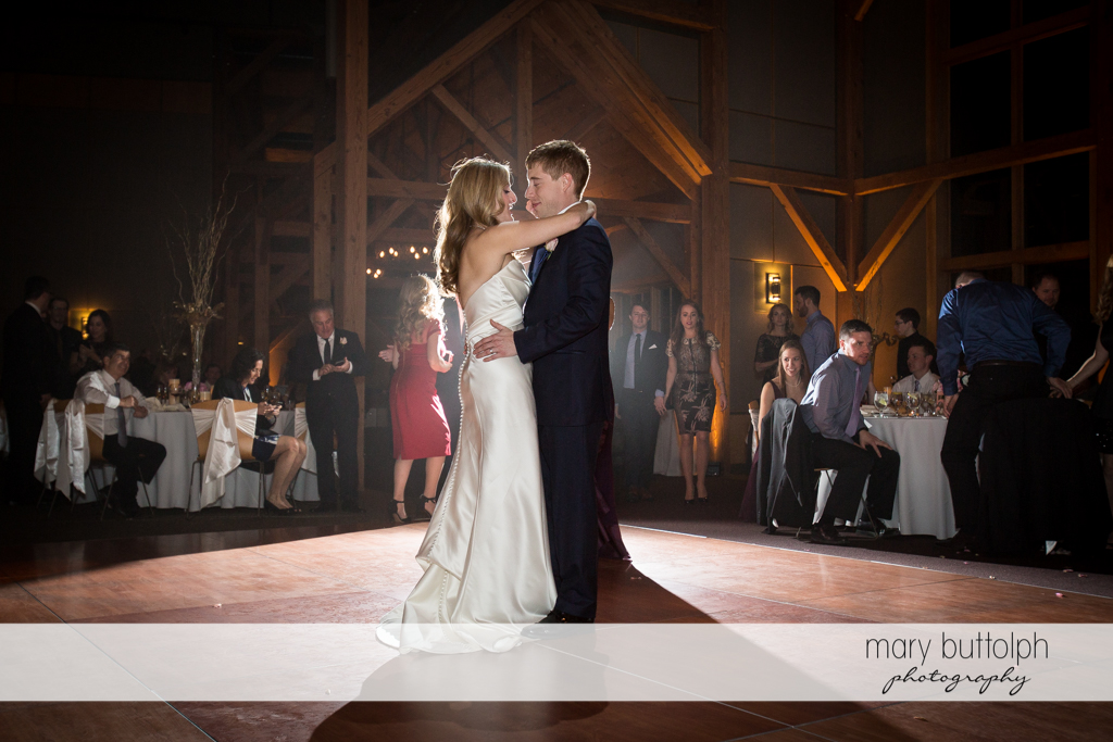 Couple share the limelight on the dance floor at the Lodge at Welch Allyn Wedding