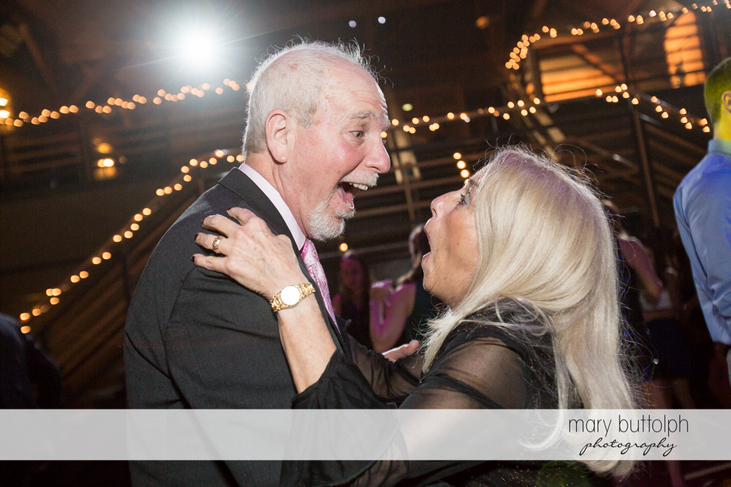 Couple's guests look surprised on the dance floor at the Lodge at Welch Allyn Wedding