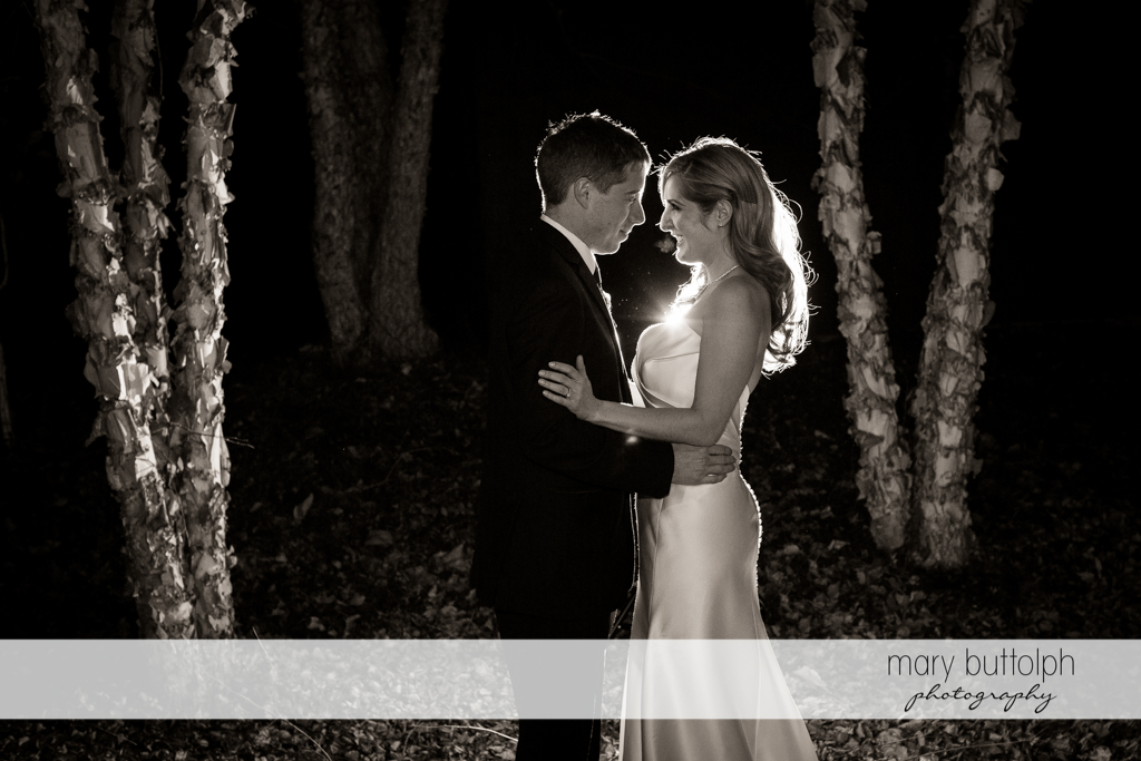 Couple surrounded by trees in the woods at the Lodge at Welch Allyn Wedding