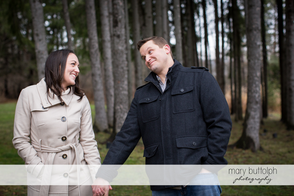 Couple stroll in the park at Skaneateles Engagement