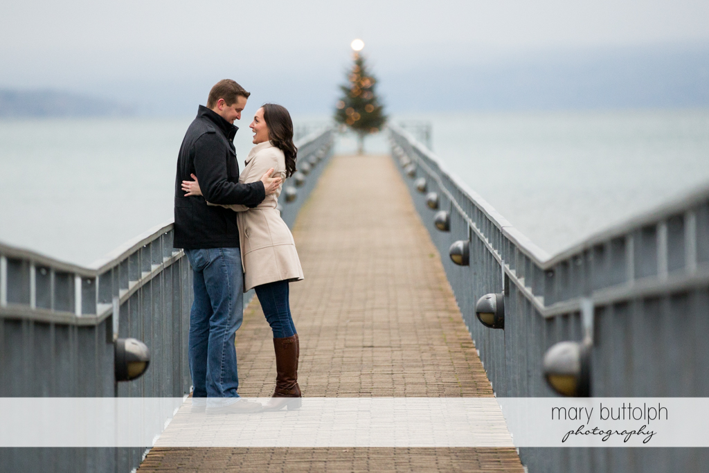 Couple pause by the lake for a romantic moment at Skaneateles Engagement