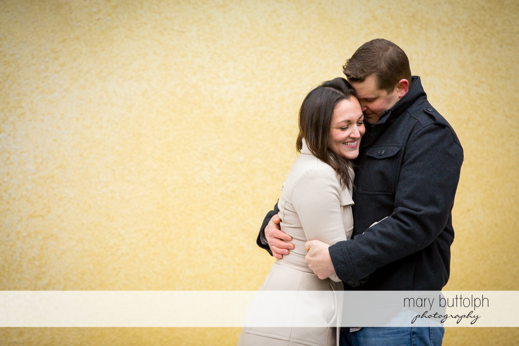 Couple embrace the moment at Skaneateles Engagement