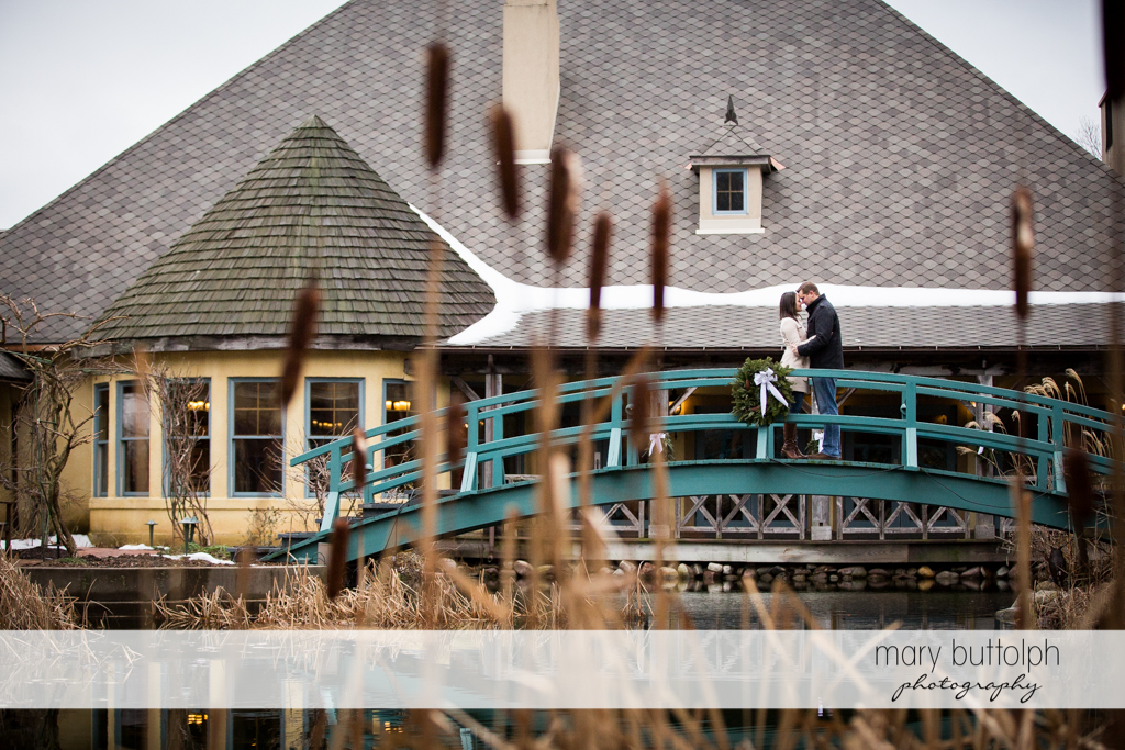 Couple stop by the bridge at Skaneateles Engagement