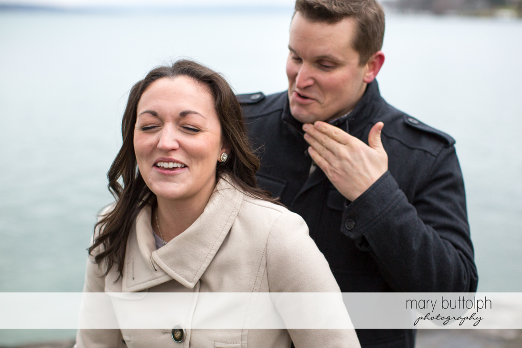 Couple share a funny moment at Skaneateles Engagement