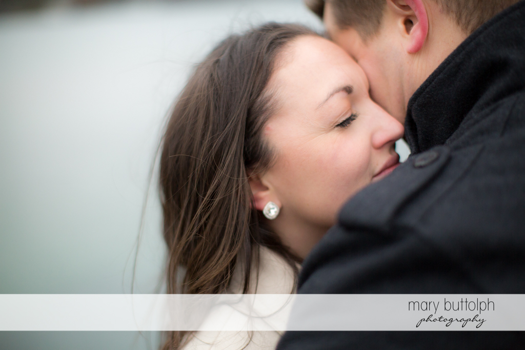 Couple share a loving embrace at Skaneateles Engagement
