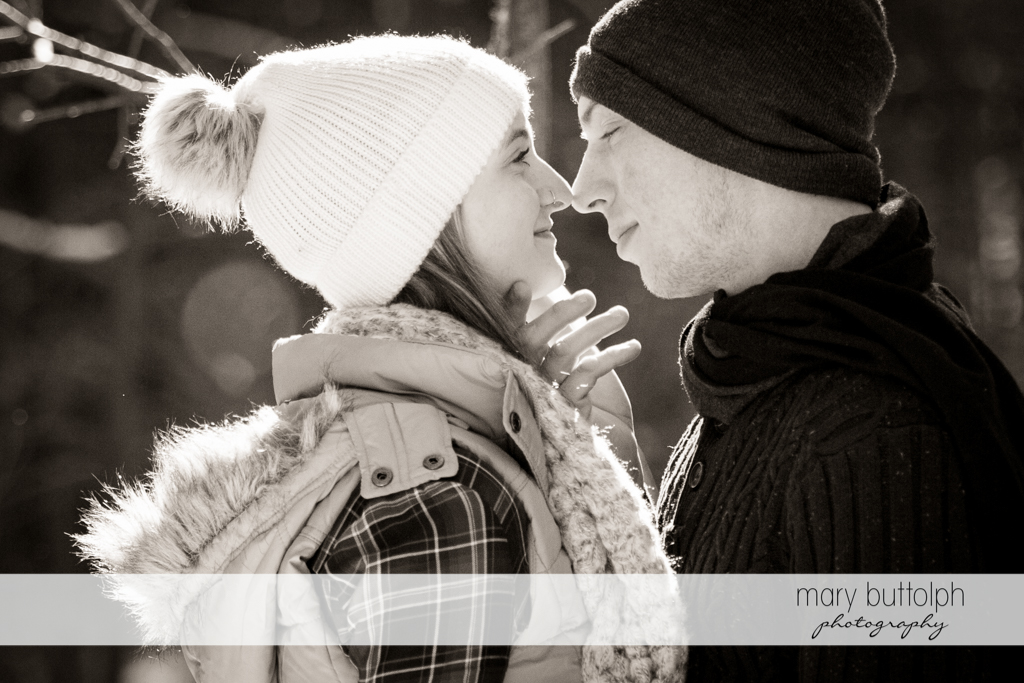 Couple rub noses in the park at Green Lakes Engagement