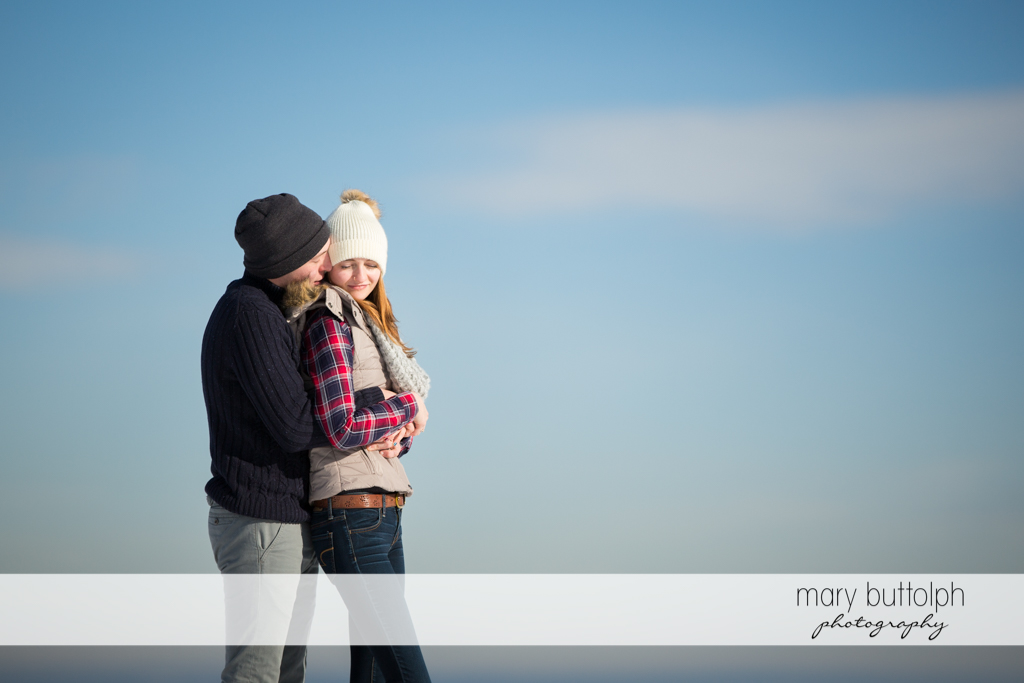 Couple pose by the lake at Green Lakes Engagement