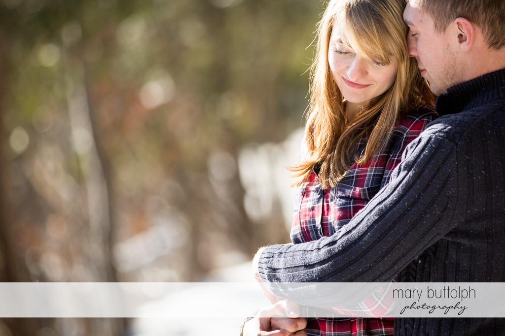 Couple embrace in the park at Green Lakes Engagement