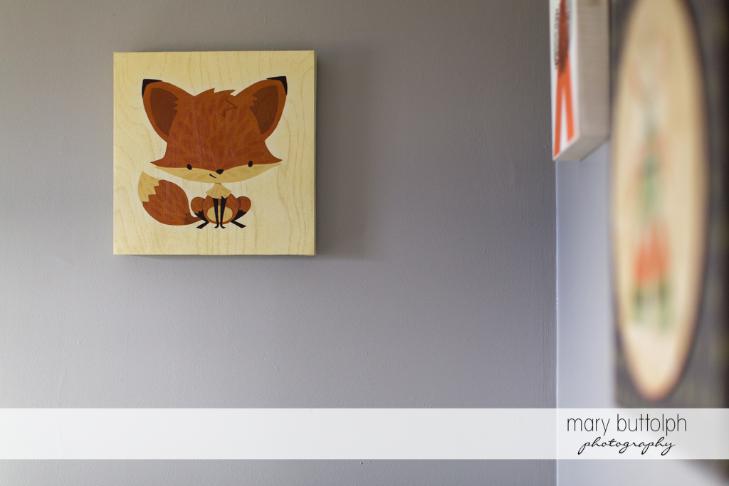 Picture of a fox hangs on the wall of baby's room at Skaneateles Newborn