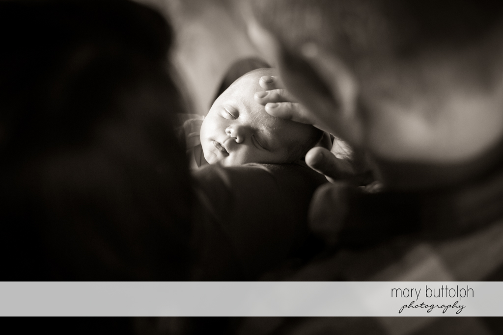 Over the shoulder shot of baby and couple at Skaneateles Newborn