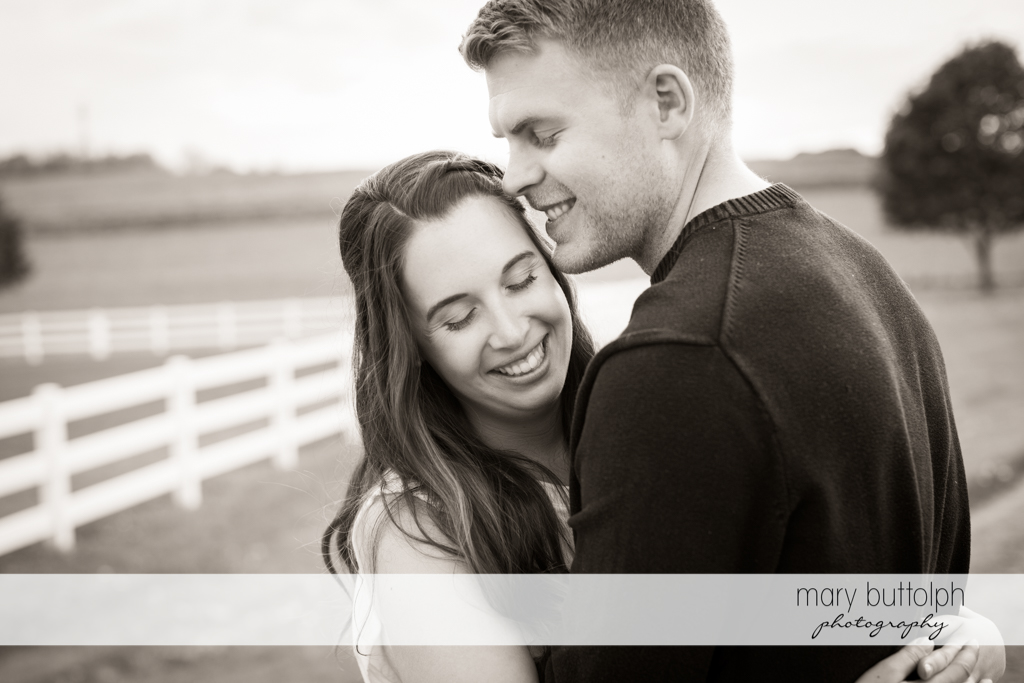 Couple are fenced in by their love at Hobbit Hollow Engagement