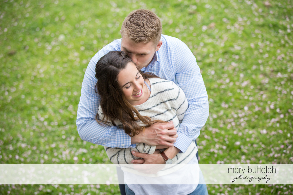 Couple n the middle of a lush garden at Hobbit Hollow Engagement
