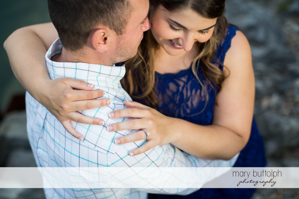 Couple cuddle up at Emerson Park Engagement