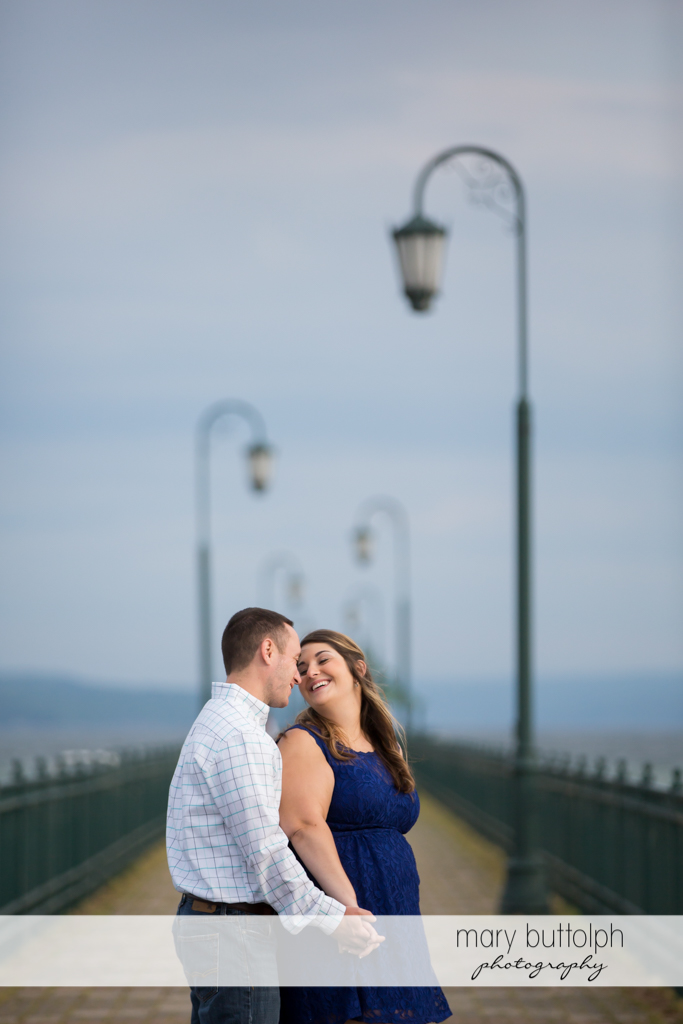 Couple relax on the bridge at Emerson Park Engagement