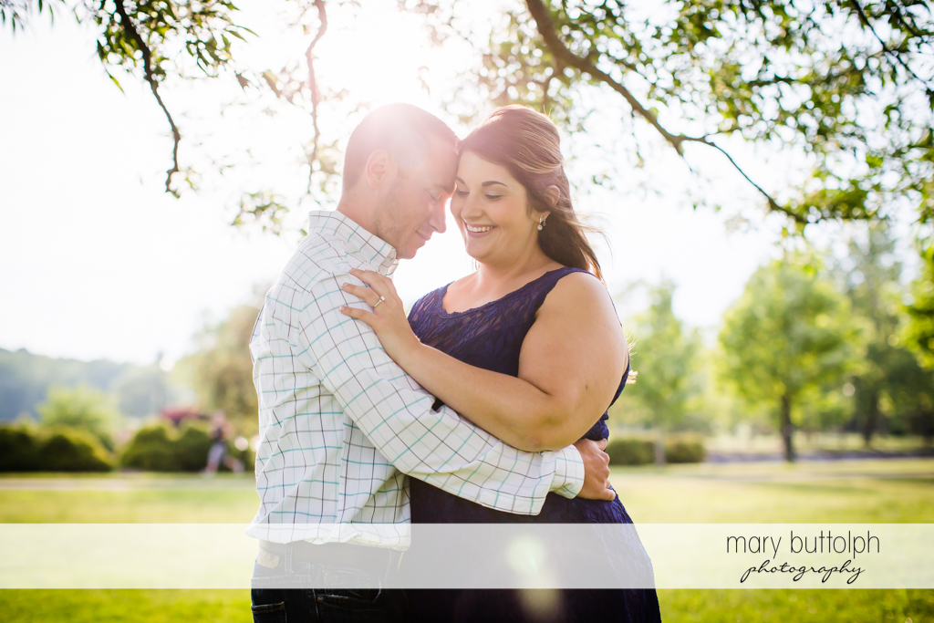 Couple enjoy the sunlight at the park at Emerson Park Engagement