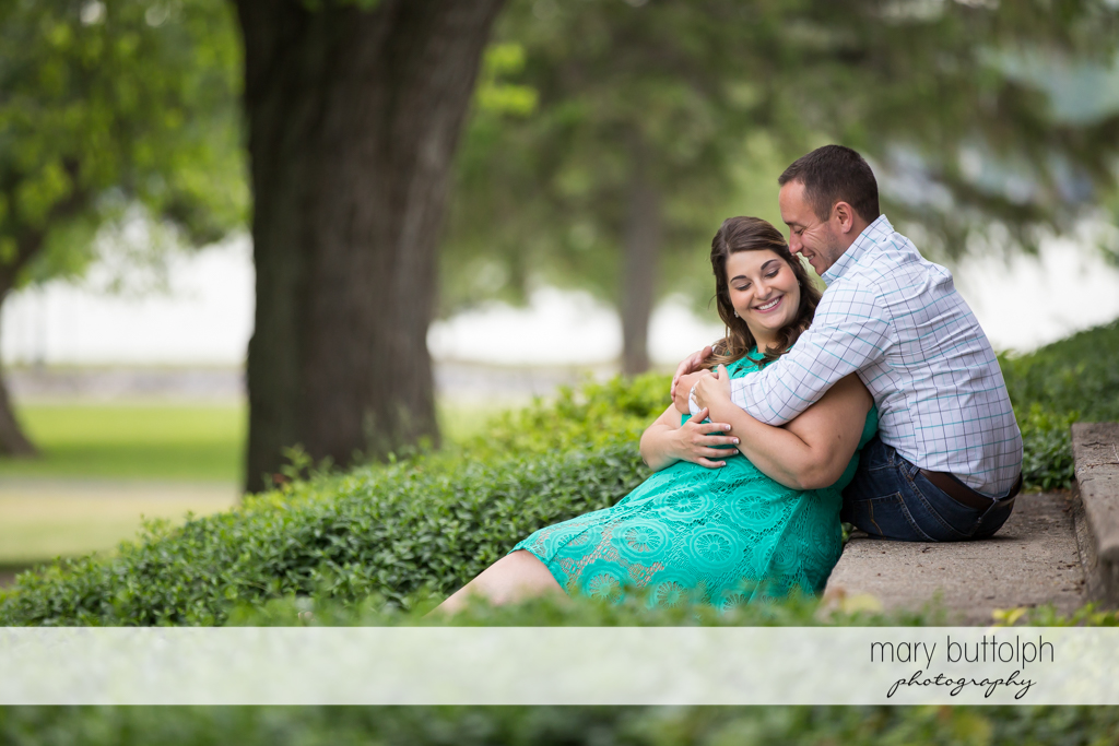 Couple relax in the park at Emerson Park Engagement