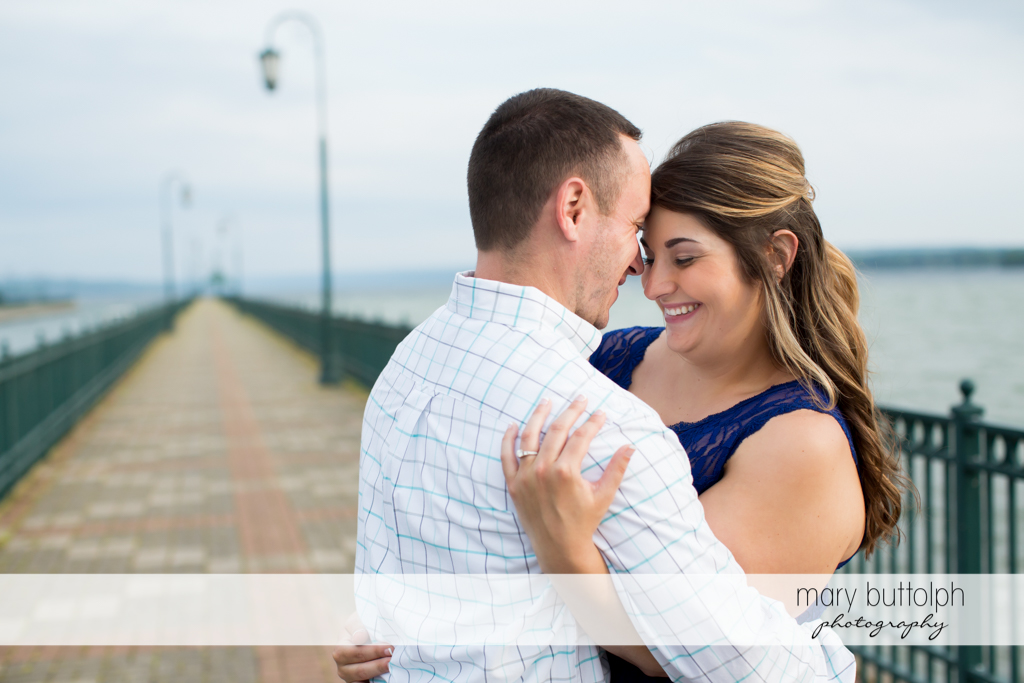 Couple dance by the lake at Emerson Park Engagement