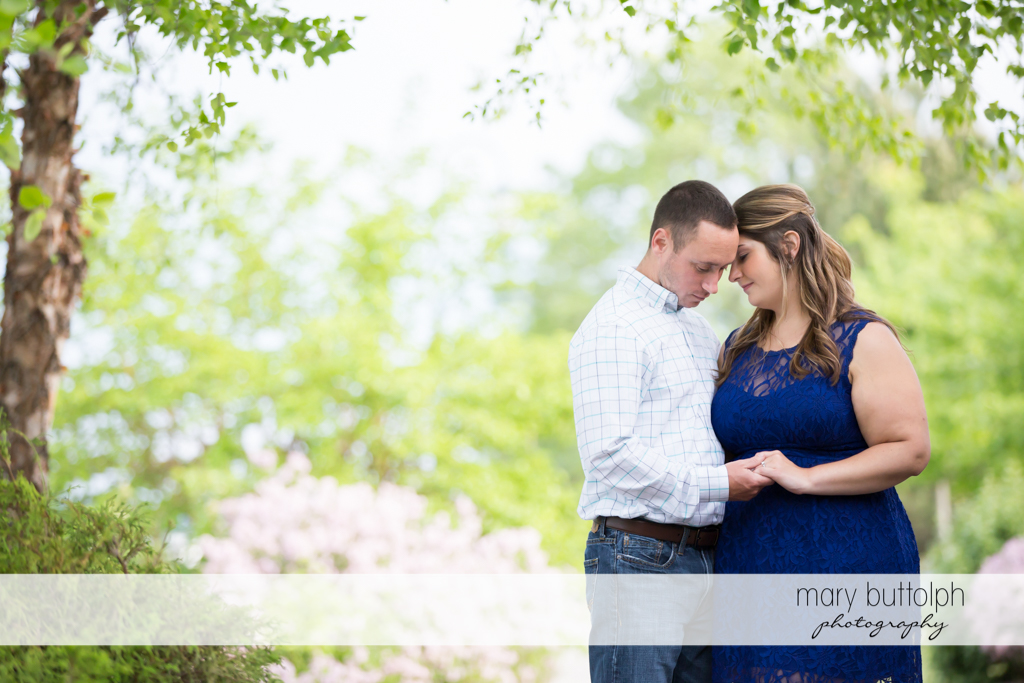 Couple have a quiet moment in the park at Emerson Park Engagement