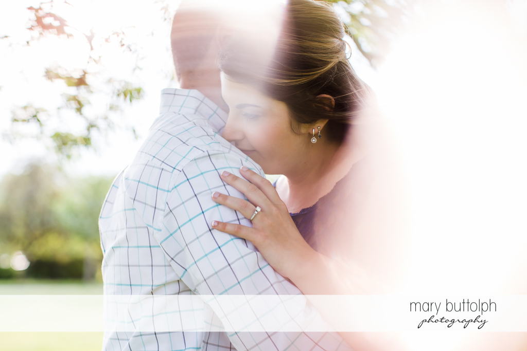 Couple shine in the sunlight at the park at Emerson Park Engagement