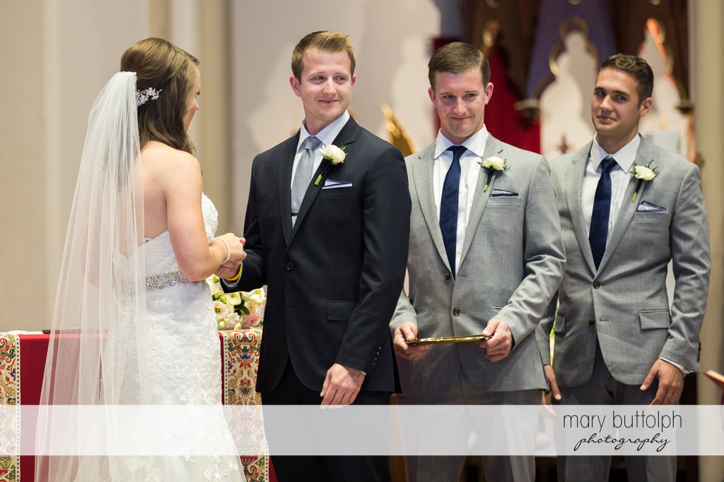 Couple and their groomsmen in church at Skaneateles Country Club Wedding
