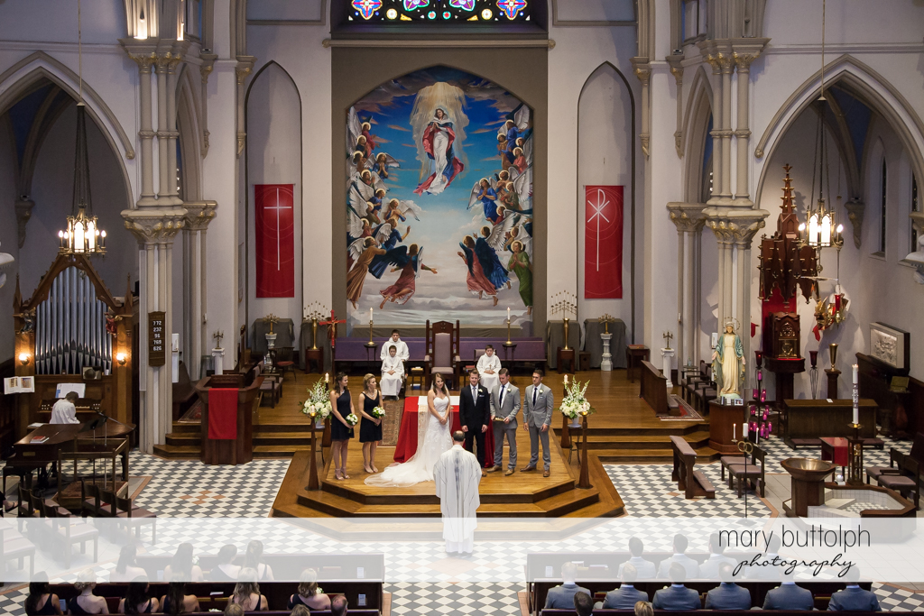 The wedding party in church at Skaneateles Country Club Wedding