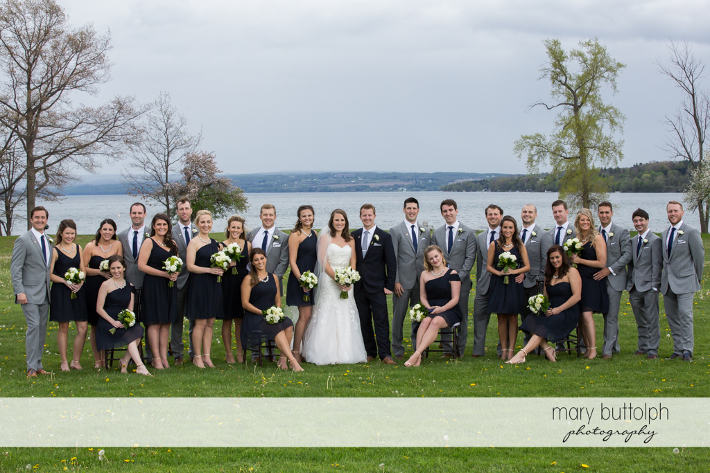The wedding party pose in front of the lake at Skaneateles Country Club Wedding