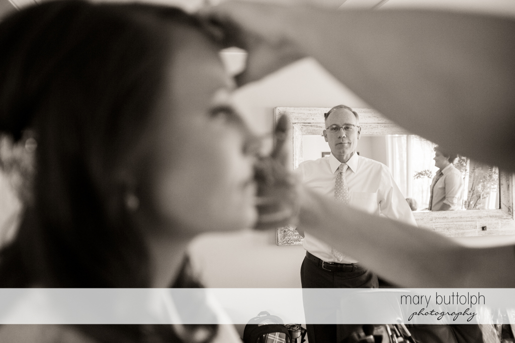 Bride's father watches his daughter being made up at Skaneateles Country Club Wedding