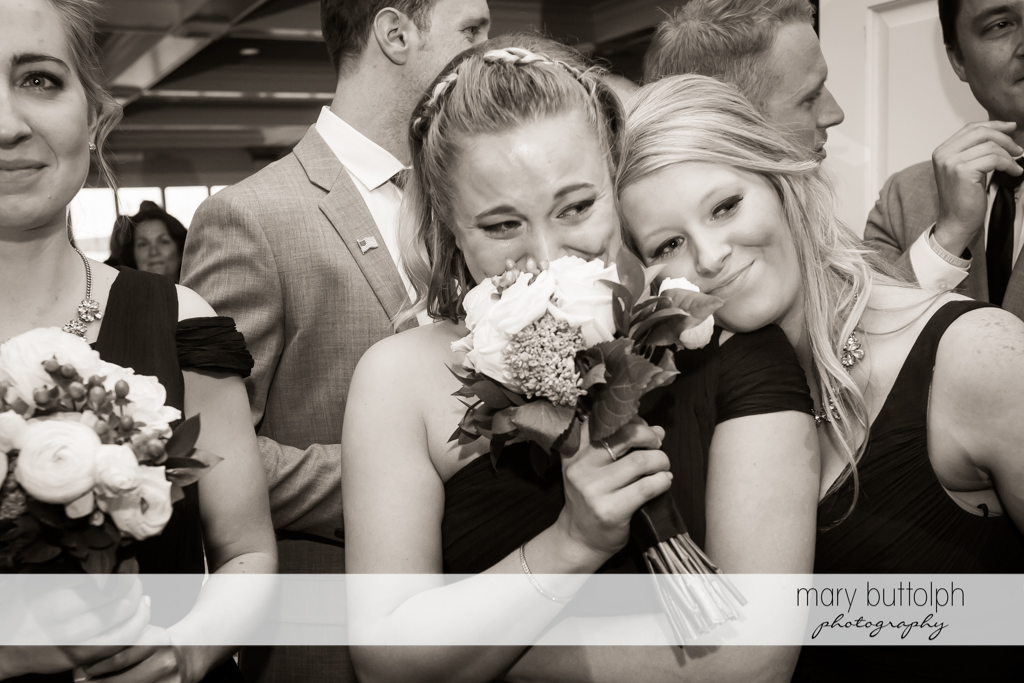 Bridesmaids get excited at the sight of the couple at Skaneateles Country Club Wedding