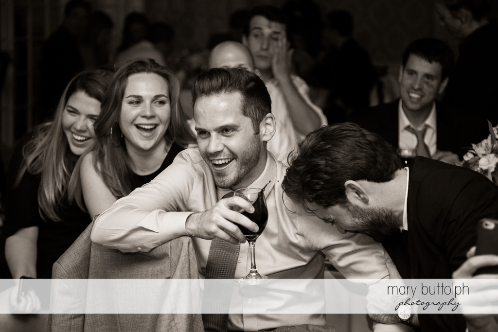 Guests have a good time at the wedding reception at Skaneateles Country Club Wedding