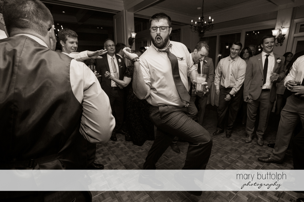 Guest conquers the dance floor with his fancy moves at Skaneateles Country Club Wedding