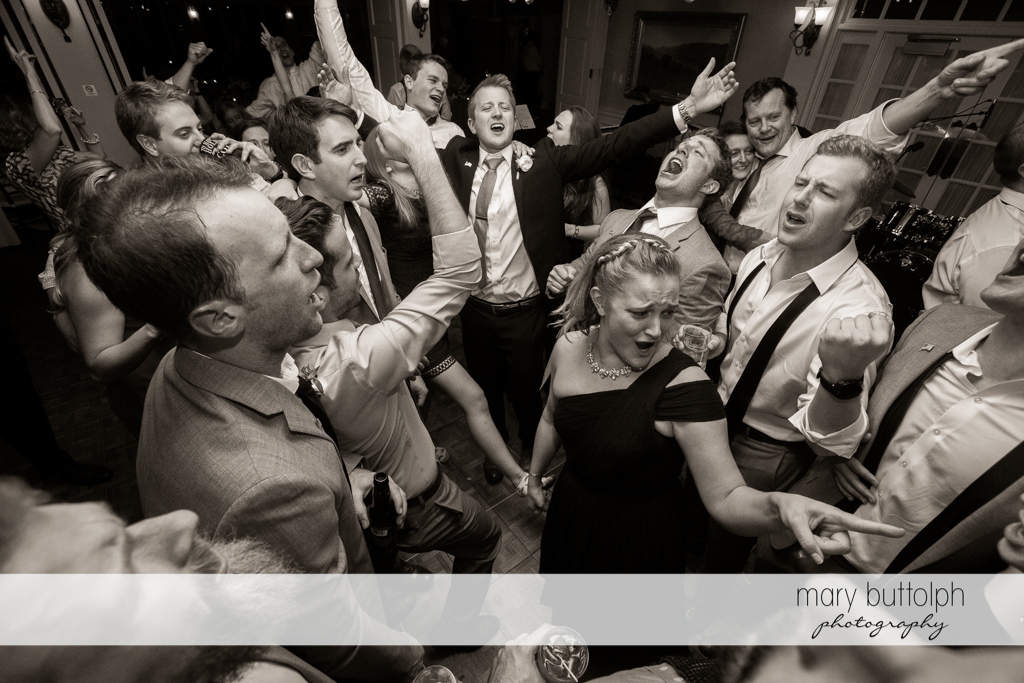 Guests party at the dance floor at Skaneateles Country Club Wedding