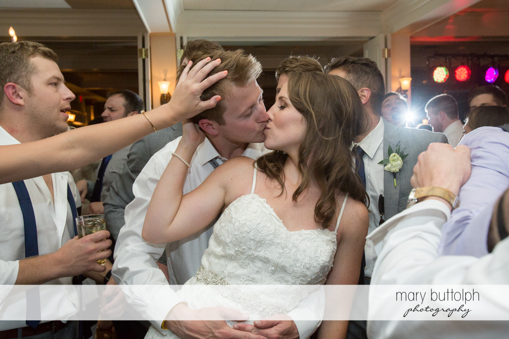 Couple kiss on the dance floor at Skaneateles Country Club Wedding