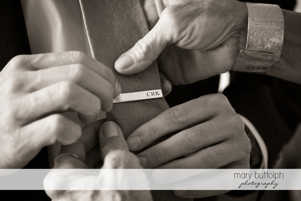 Close up shot of a tie being adjusted before the wedding at Skaneateles Country Club Wedding