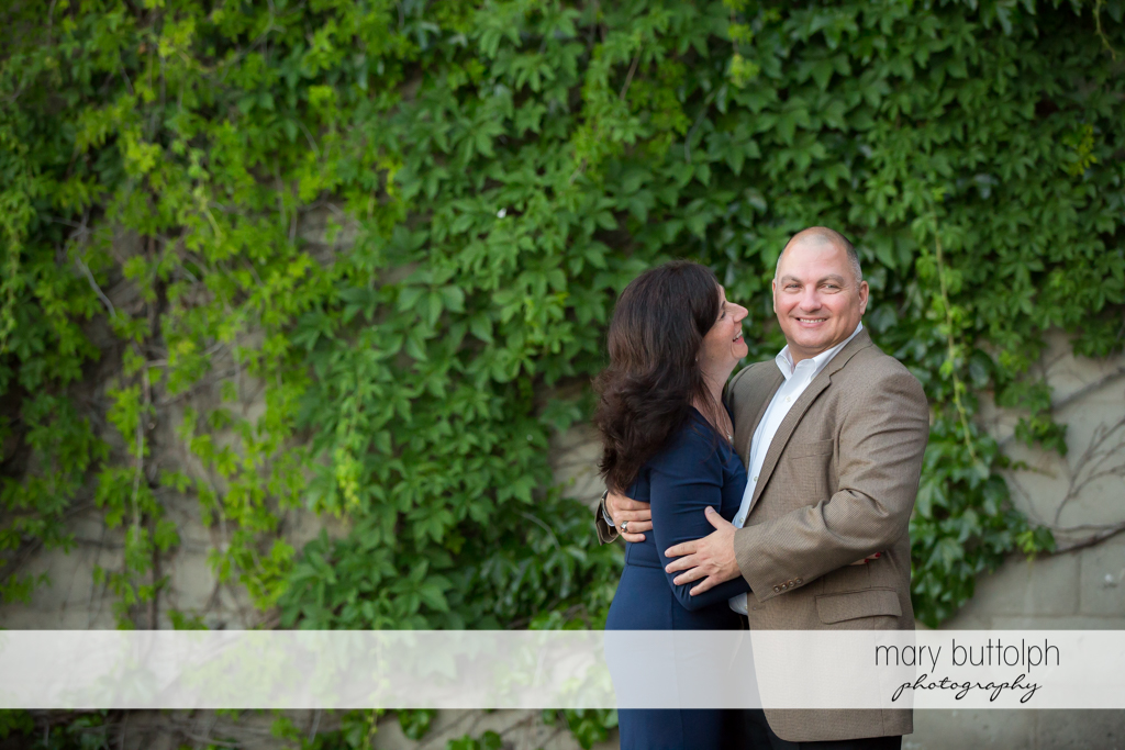 Couple in a good mood in front of a wall at Skaneateles Engagement