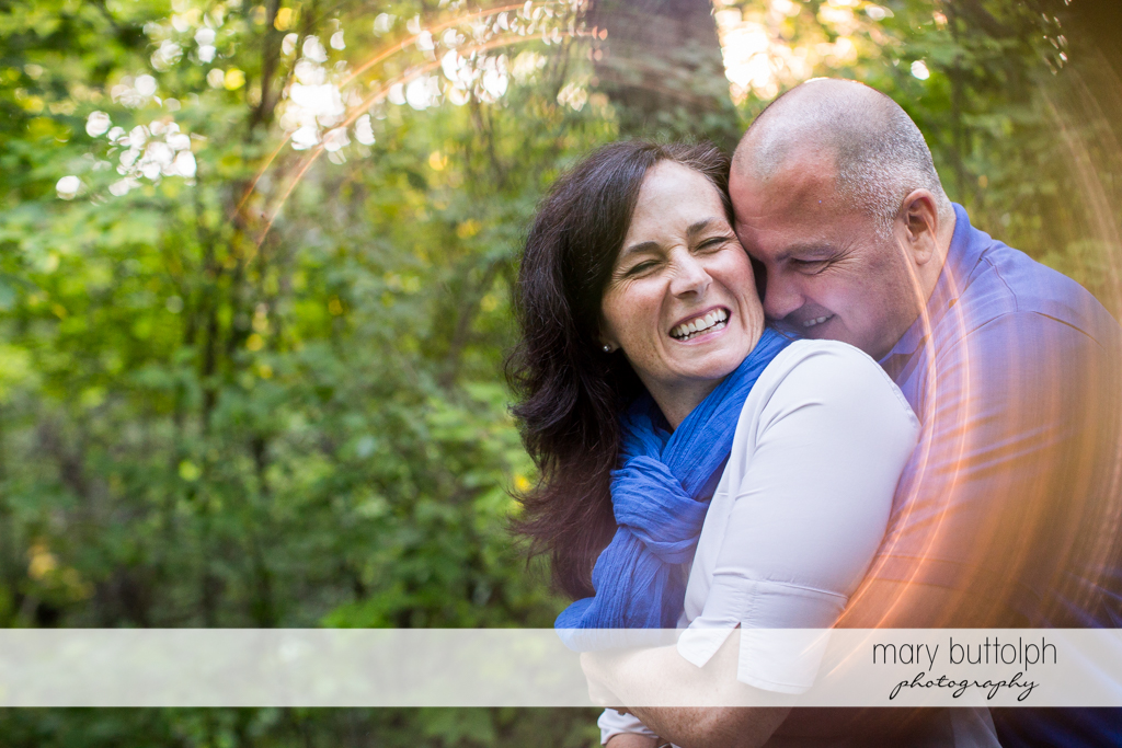 Couple share good times in the park at Skaneateles Engagement