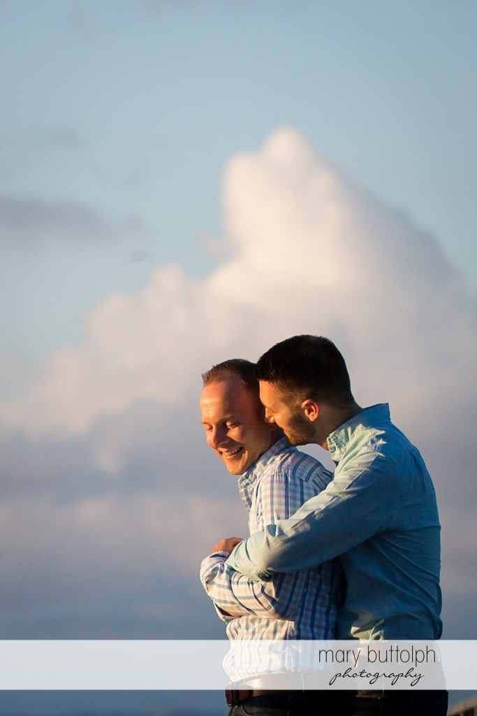 Same sex couple enjoy the cool morning breeze at Skaneateles Engagement