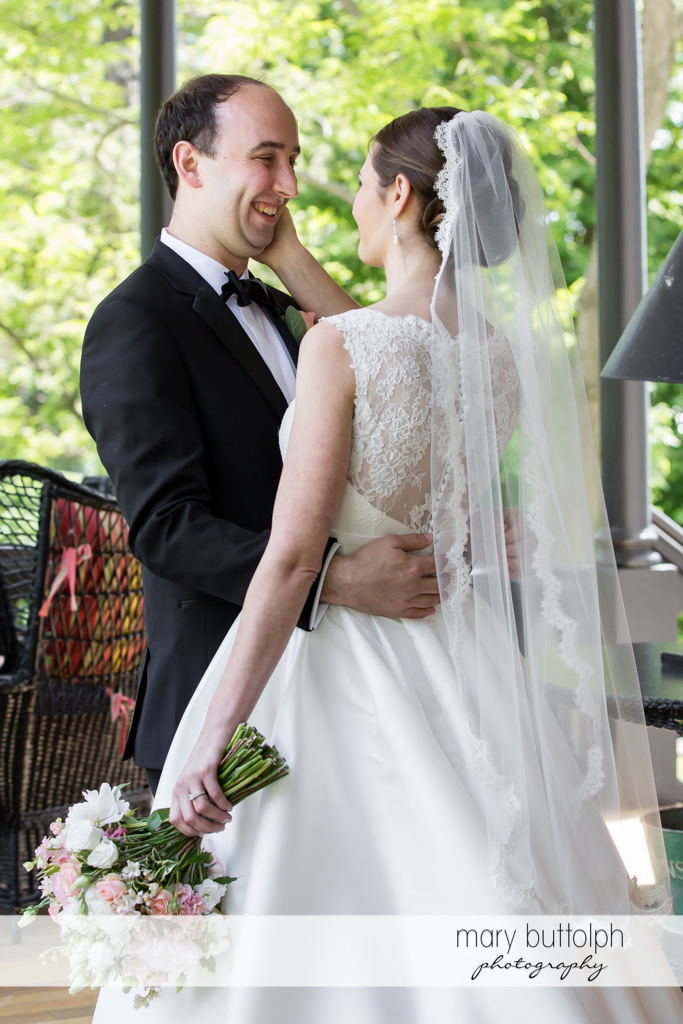 Couple embrace on the porch at the Inns of Aurora Wedding