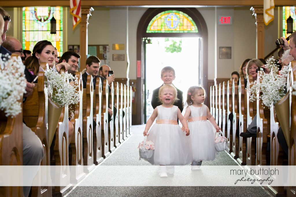 Flower girls and ring bearer walk down the aisle at the Inns of Aurora Wedding
