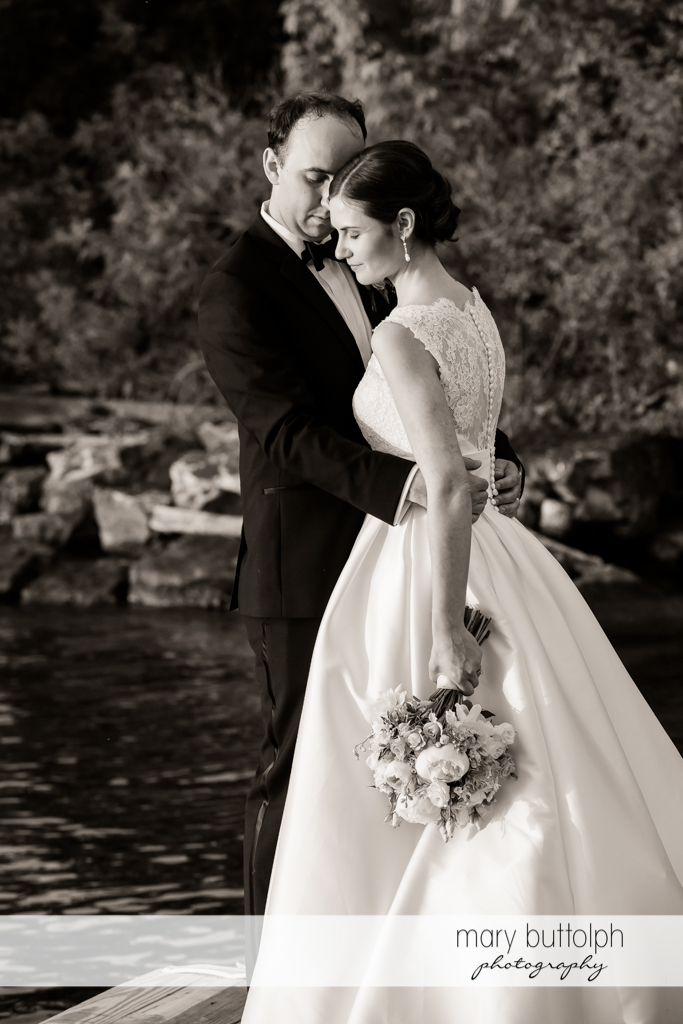 Couple in dramatic black and white shot near the lake at the Inns of Aurora Wedding