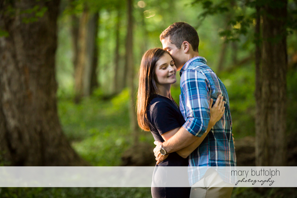 Couple share an intimate moment in the park at Finger Lakes Engagement