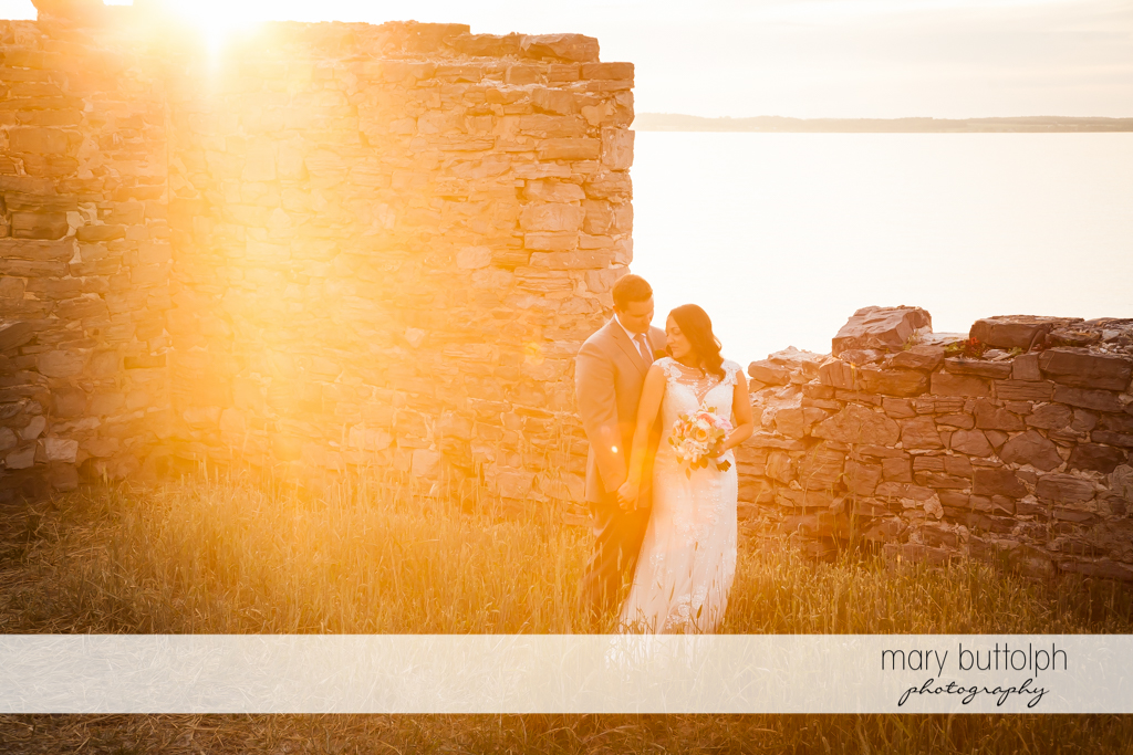 Couple stand in front of the ruins at the Inns of Aurora Wedding