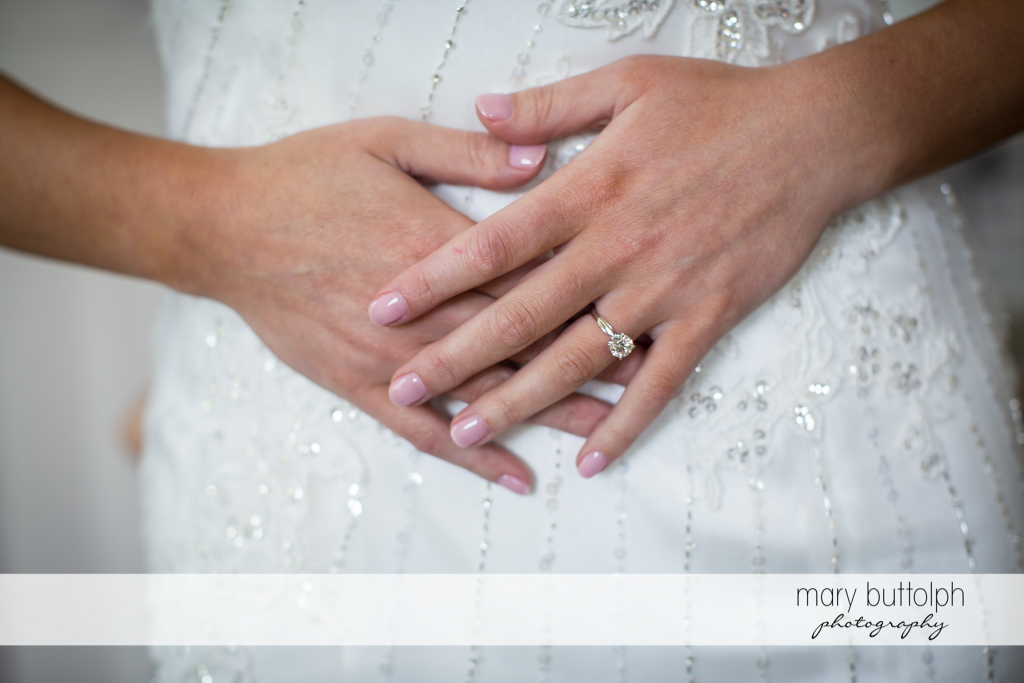 Bride proudly displays her engagement ring at the Inns of Aurora Wedding