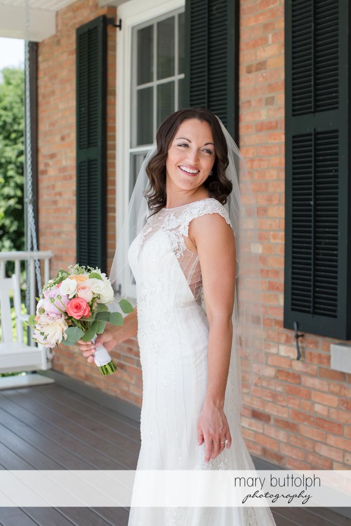 Bride looks beautiful in her wedding dress at the Inns of Aurora Wedding