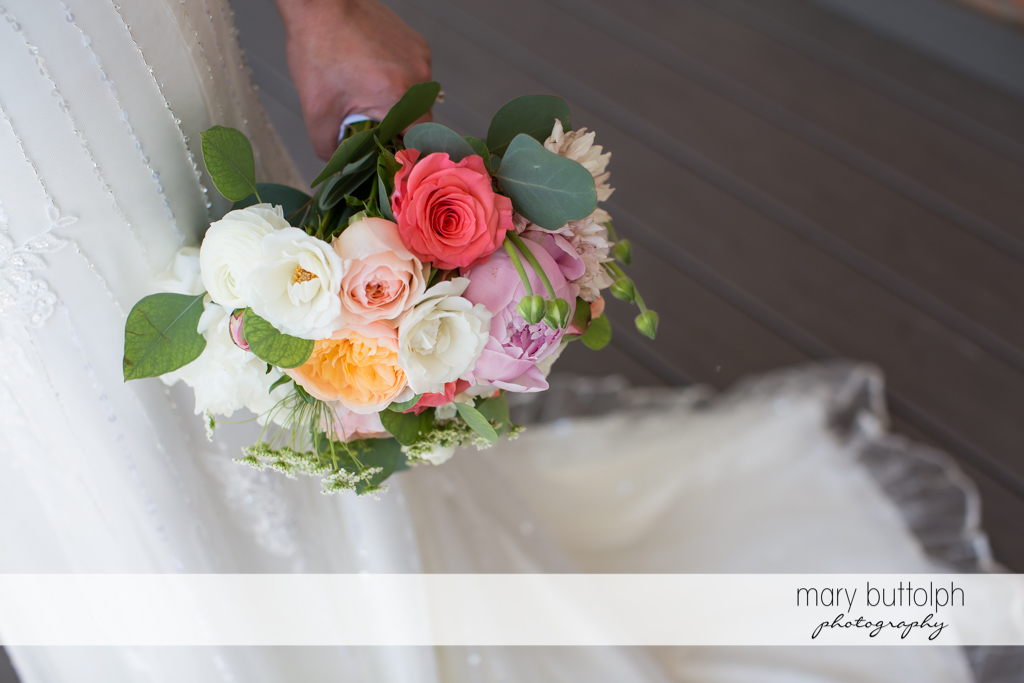 Bride holds a colorful bouquet at the Inns of Aurora Wedding