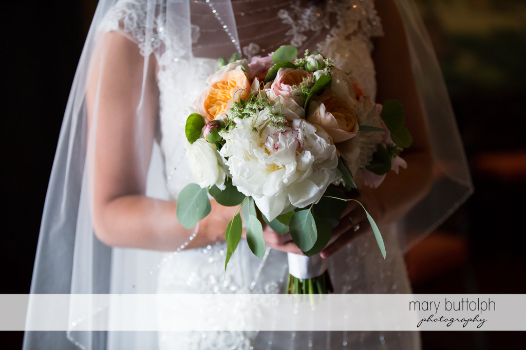 Half body shot of bride and her bouquet at the Inns of Aurora Wedding