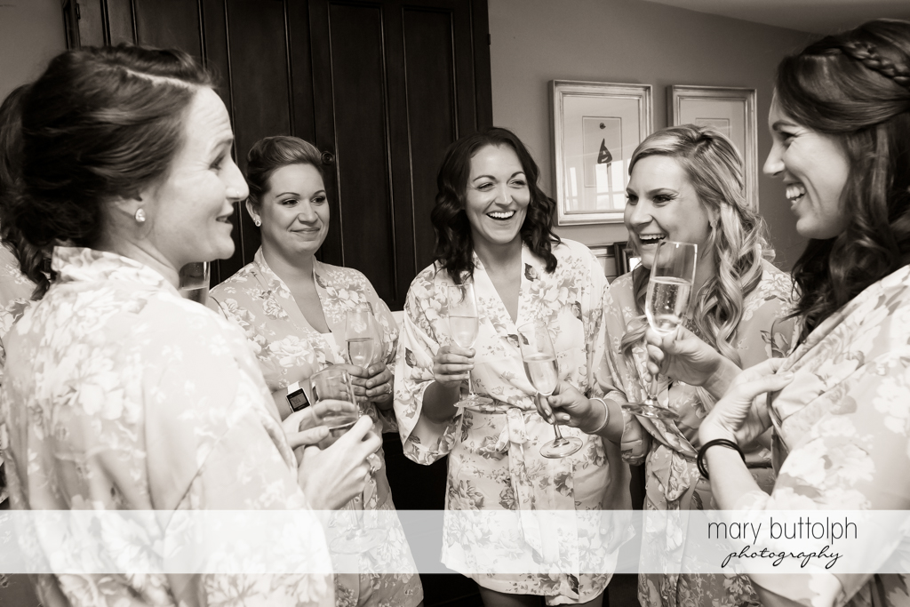 Bride talks to the bridesmaids at the dressing room at the Inns of Aurora Wedding