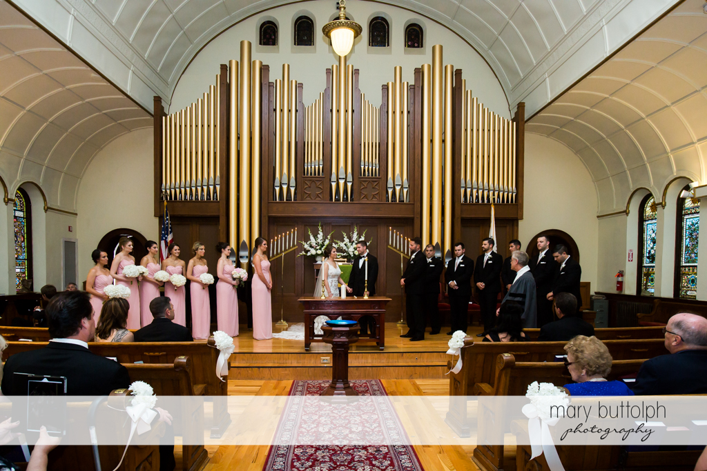 The wedding party at the altar at The Lodge at Welch Allyn Wedding